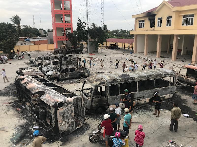Charred buses at a police station compound in central Binh Thuan province following the June 10 violent protests
