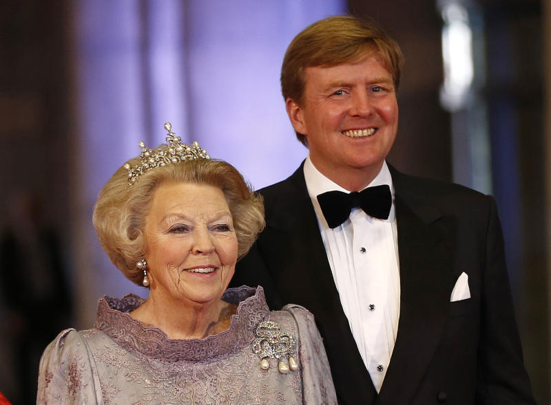 Dutch Queen Beatrix and her son Dutch Crown Prince Willem-Alexander pose for photographers as they arrive for a banquet hosted by the Dutch Royal family at the Rijksmuseum, Amsterdam, The Netherlands, Monday, April 29, 2013. Queen Beatrix has announced she will relinquish the crown on April 30, 2013, after 33 years of reign, leaving the monarchy to her son Crown Prince Willem-Alexander. (AP Photo/Daniel Ochoa de Olza)