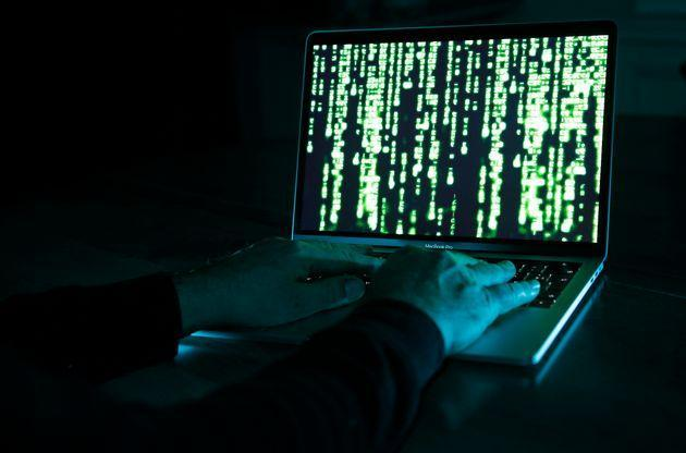 PARIS, FRANCE - DECEMBER 27: In this photo illustration, a hacker with an Anonymous mask on his face and a hood on his head uses a computer on December 27, 2019 in Paris, France. In IT security, a hacker is an IT specialist, who is looking for ways to bypass software and hardware protections. Hackers are generally intelligent programmers who seek to manipulate or modify a computer system or network. (Photo by Chesnot/Getty Images) (Photo: Chesnot via Getty Images)