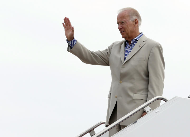 Vice President Joe Biden waves before he turns to board Air Force Two, Sunday, Sept. 2, 2012, at Andrews Air Force Base, Md., en route to York, Pa. (AP Photo/Carolyn Kaster)