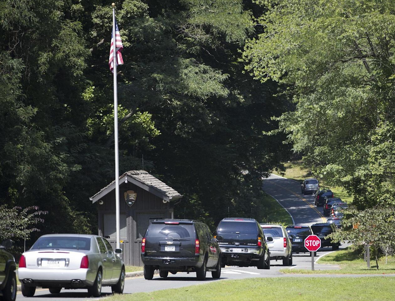 Motorcade vehicles escorting President Barack Obama and members of his family arrive at entrance to Prince William Forest Park in Va., Sunday, Aug. 28, 2016. The president and first family are planning on hiking at the national park during their visit to the area. (AP Photo/Pablo Martinez Monsivais)