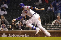 Chicago Cubs' Kris Bryant watches his RBI single off Washington Nationals starting pitcher Patrick Corbin during the fifth inning of a baseball game Tuesday, May 18, 2021, in Chicago. (AP Photo/Charles Rex Arbogast)