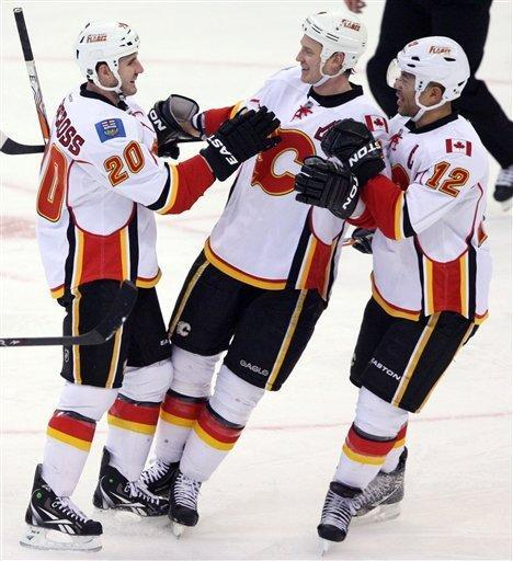 Calgary Flames' Curtis Glencross (20) celebrates his goal with teammates Jarome Inginla (12) and Jay Bouwmeester (4) during first-period NHL hockey game action against the Ottawa Senators in Ottawa, Ontario, Friday, Dec. 30, 2011. (A{P Photo/The Canadian Press, Fred Chartrand)
