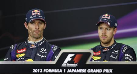 Mark Webber of Australia sits next to first-placed Red Bull Formula One driver Sebastian Vettel of Germany during a news conference after the Japanese F1 Grand Prix at the Suzuka circuit October 13, 2013. REUTERS/Issei Kato