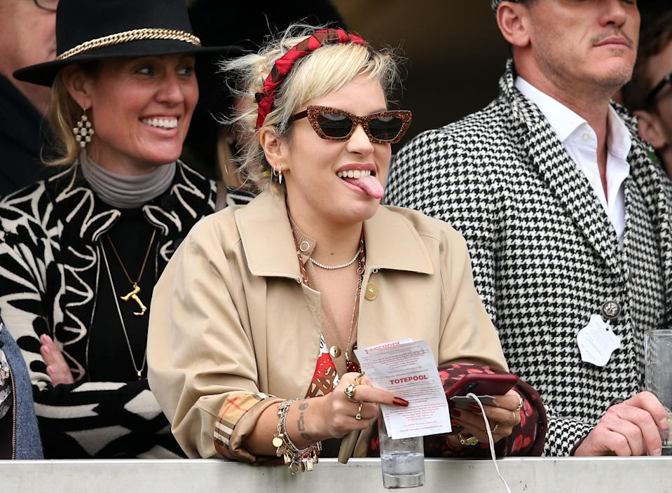 Lily Allen reacts during Gold Cup Day of the 2019 Cheltenham Festival at Cheltenham Racecourse.