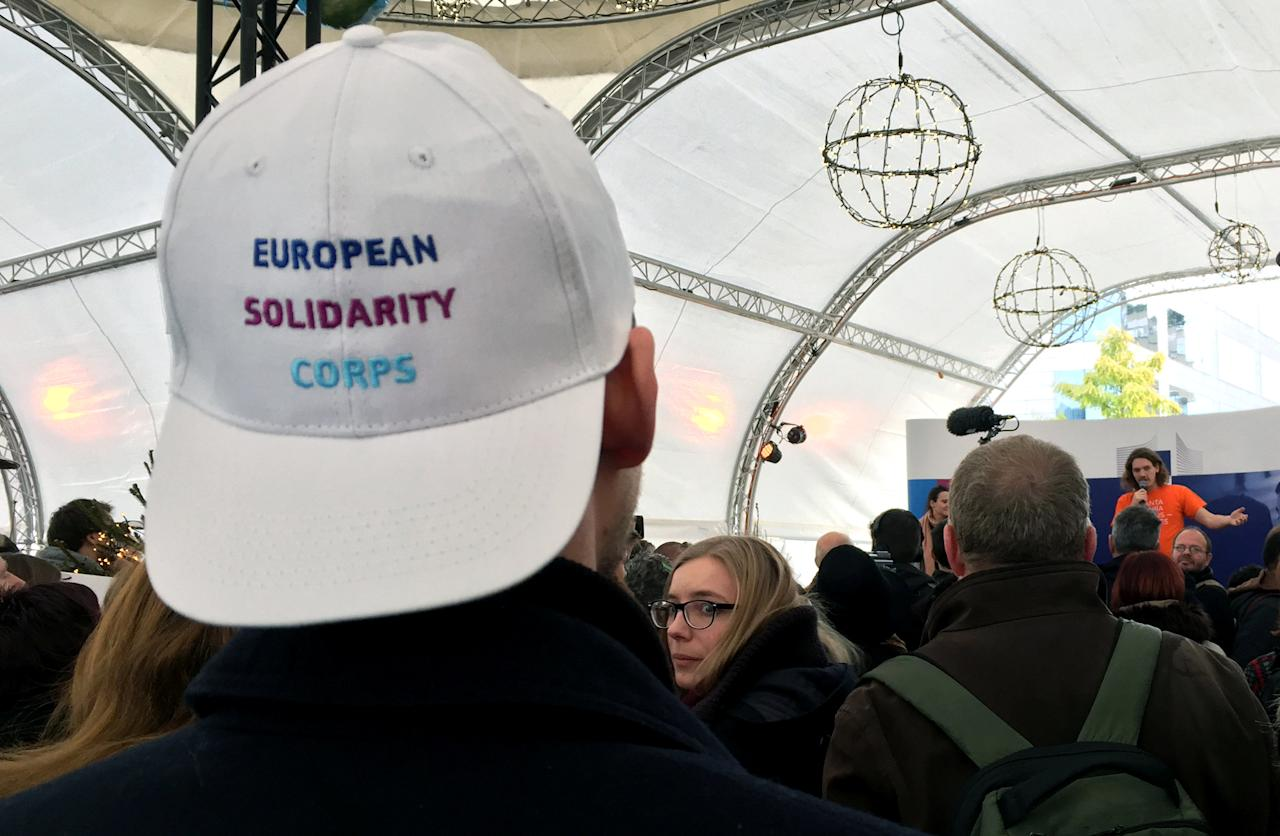 Youths attend the launch of the European Solidarity Corps, a new initiative for young people to travel and help out people in difficulty across the continent, outside the European Commission headquarters in Brussels, Belgium December 7, 2016.   REUTERS/Marilyn Haigh FOR EDITORIAL USE ONLY. NO RESALES. NO ARCHIVES