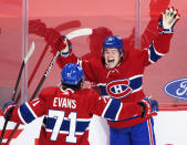 FILE - In this May 1, 2021, file photo, Montreal Canadiens' Cole Caufield (22) celebrates with teammate Jake Evans after scoring against the Ottawa Senators during overtime of an NHL hockey game in Montreal. Caufield was dominating college hockey in late March and by late May was a regular in the lineup of the most storied franchise in the NHL, helping the Canadiens advance to the third round of the playoffs. (Graham Hughes/The Canadian Press via AP, File)