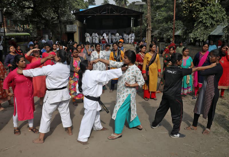 Women practice self-defense techniques at a training camp in Kolkata