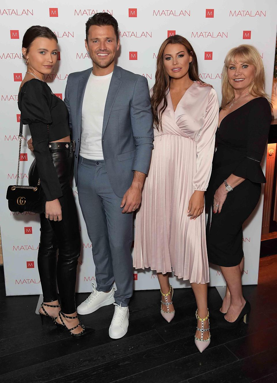 Mark with his sisters Natalya (left) and Jess, and mother CaroleDave Benett/Getty Images for Matalan
