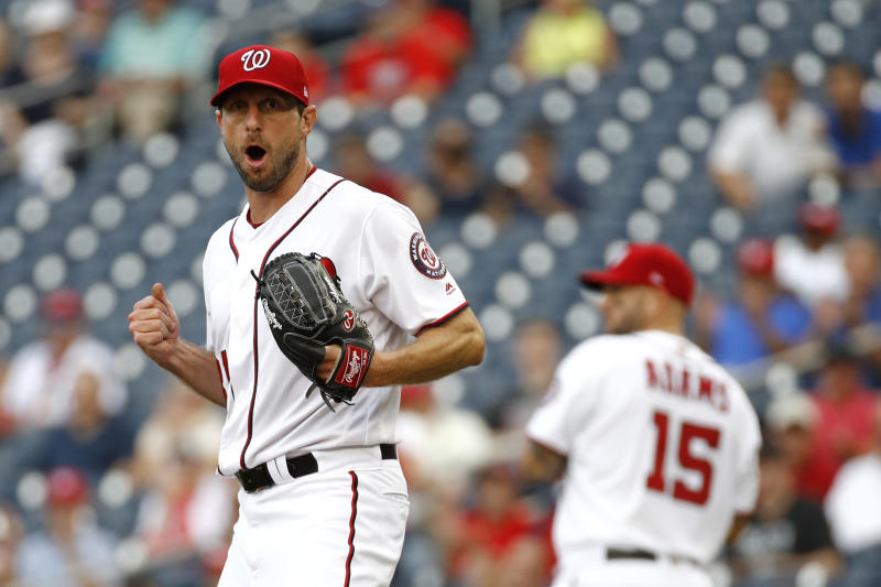 Washington Nationals starting pitcher Max Scherzer reacts after third baseman Anthony Rendon threw out Colorado Rockies' Raimel Tapia at first base on a ground ball in the second inning of a baseball game, Thursday, July 25, 2019, in Washington. (AP Photo/Patrick Semansky)