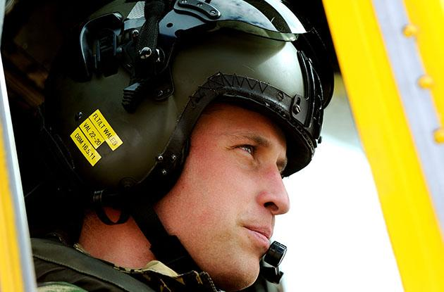 Prince William at the controls of a Sea King helicopter. (Photo by John Stillwell/Getty)