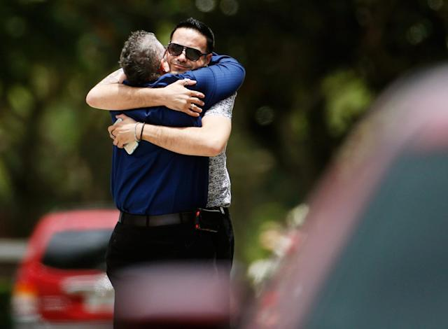 <p>Two mourners embrace ahead of the funeral of Kimberly Morris in Kissimmee, Fla. <em>(Photo: Carlo Allegri/Reuters)</em> </p>