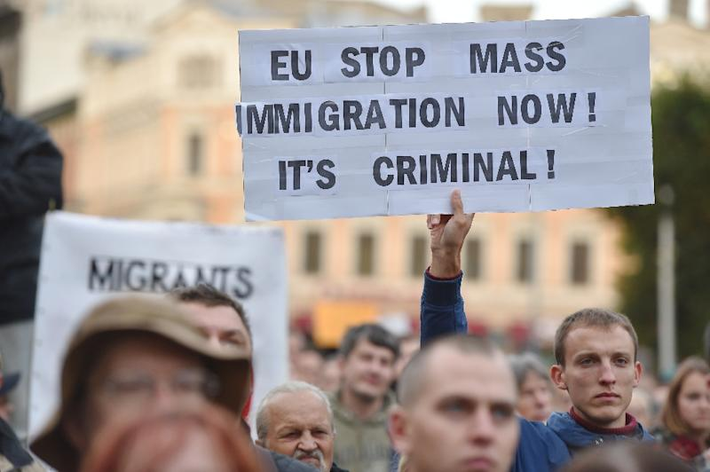People protest against the arrival of migrants in Latvia, near the Freedom Monument in Riga on September 22, 2015 (AFP Photo/Ilmars Znotins)