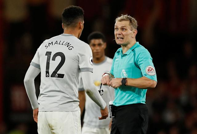 "Soccer Football - Premier League - AFC Bournemouth vs Manchester United - Vitality Stadium, Bournemouth, Britain - April 18, 2018 Manchester United's Chris Smalling speaks with referee Graham Scott Action Images via Reuters/John Sibley EDITORIAL USE ONLY. No use with unauthorized audio, video, data, fixture lists, club/league logos or ""live"" services. Online in-match use limited to 75 images, no video emulation. No use in betting, games or single club/league/player publications. Please contact your account representative for further details."