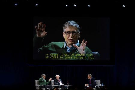 Bill Gates is seen on a video screen as Warren Buffett (C), chairman and CEO of Berkshire Hathaway, and moderator Charlie Rose listen at Columbia University in New York, U.S., January 27, 2017. REUTERS/Shannon Stapleton