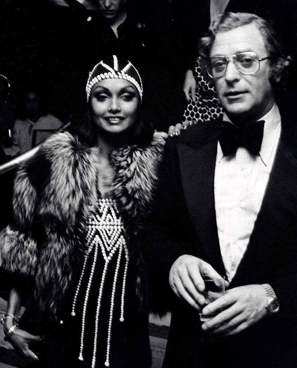 """<p>Michael Caine and wife Shakira Caine attend the premiere party for """"The Man Who Would Be King"""" on December 16, 1975 at Nathan's in New York City.</p>"""