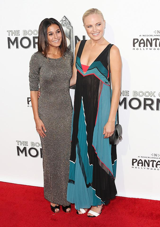 """Good friends Emmanuelle Chriqui and Malin Akerman posed together on the red carpet. While the """"Entourage"""" went for a more glitzy look in her shimmery number, the """"Rock of Ages"""" star opted for a flowing BCBGMaxAzria maxi dress. (9/12/2012)"""