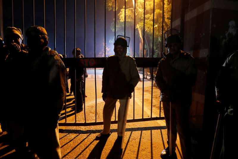 Police in riot gear stand guard outside the Jawaharlal Nehru University (JNU) after clashes between students in New Delhi