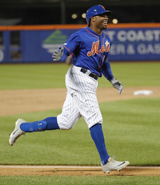 New York Mets Rajai Davis smiles while running the bases after hitting a three-run home run during the eighth inning of the team's baseball game against the Washington Nationals, Wednesday, May 22, 2019, in New York. (AP Photo/Kathy Willens)
