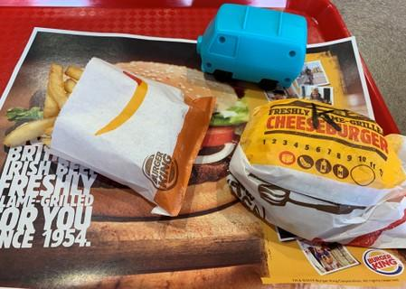 A plastic toy is seen on a tray containing a child's cheeseburger meal in this photo illustration taken inside a Burger King restaurant in Manchester