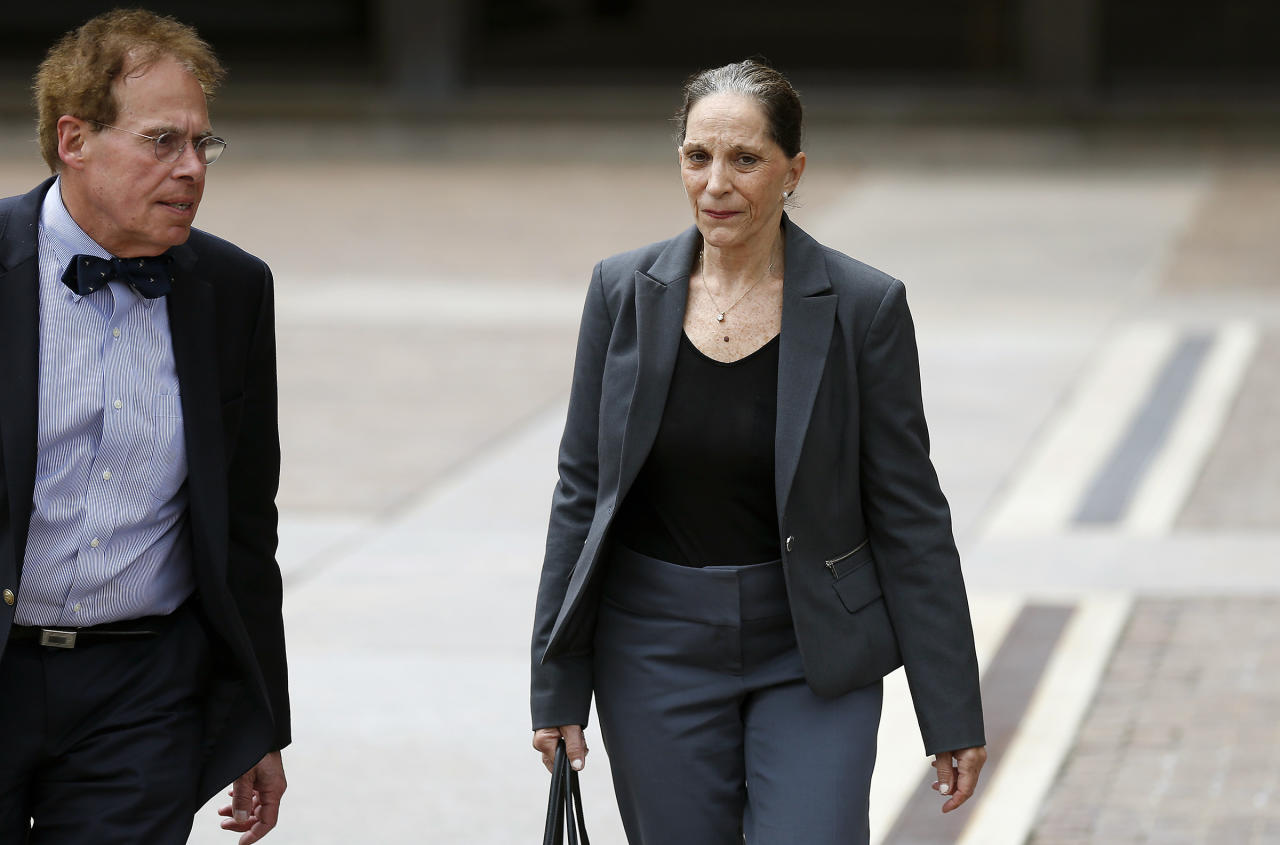 <p> Renee Tartaglione leaves the federal courthouse in Philadelphia, Friday, June 23, 2017. Tartaglione, a member of a politically connected Philadelphia family, has been convicted of defrauding a nonprofit mental health clinic out of about $1 million for her personal benefit. A U.S. District Court jury convicted Tartaglione Friday on all counts of conspiracy, theft, fraud and tax evasion. (David Maialetti /The Philadelphia Inquirer via AP) </p>
