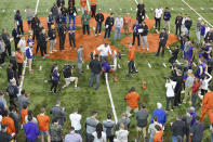 FILE - In this March 12, 2020, file photo, Clemson football player Tee Higgins lifts weights during NFL Pro Day in Clemson, S.C. Scouts, front-office executives and even coaches find themselves coping with a whole new process with Americans hunkering down and doctors overwhelmed by the mounting cases of COVID-19. Gone for the most part this year are access to in-person interviews, campus workouts and visits to team headquarters. (AP Photo/Richard Shiro, File)