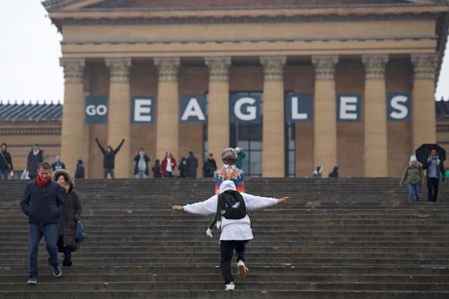 A fan flaps his arms while running up the Philadelphia Art Museum, before the Super Bowl LII game between the Philadelphia Eagles and New England Patriots, in Philadelphia, Pennsylvania, U.S., February 4, 2018. REUTERS/Mark Makela