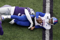 Kansas quarterback Jalon Daniels (17) is sacked by Kansas State defensive end Felix Anudike (91) during the second half of an NCAA football game Saturday, Oct. 24, 2020, in Manhattan, Kan. (AP Photo/Charlie Riedel)