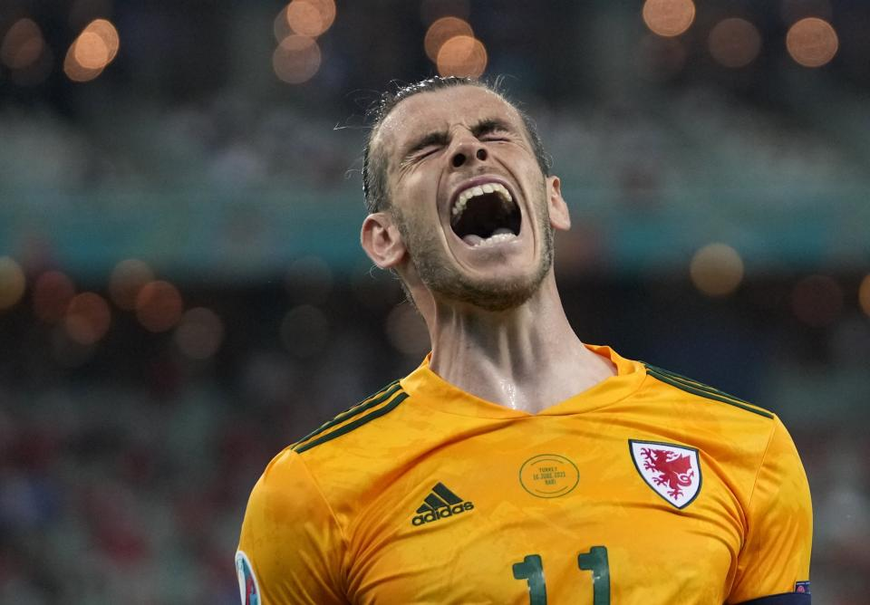 Wales' Gareth Bale celebrates after his teammate Wales' Connor Roberts scored his sides second goal during the Euro 2020 soccer championship group A match between Turkey and Wales the Baku Olympic Stadium in Baku, Azerbaijan, Wednesday, June 16, 2021. (AP Photo/Darko Vojinovic, Pool)