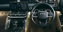 <p>Inside, there's an available 12.3-inch infotainment screen—a 9.0-inch screen is standard and the size on the previous-gen model—that can display the truck's four exterior cameras including an underside view. A single dial is used to control the drive modes, downhill assist control, and crawl control, which acts like an off-road cruise control. Unlike the 200 series, which used a dial to engage four-wheel drive, the new truck uses a switch in front of the gear selector. There's also a 14-speaker JBL sound system and an available center console cooler. </p>