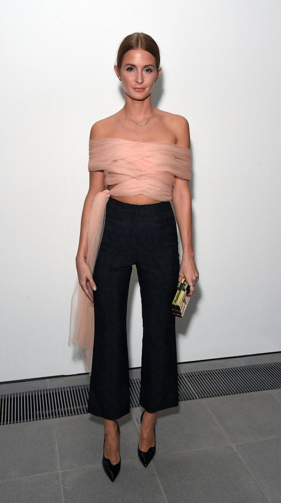 <p>Millie Mackintosh chose a tulle pink top and tux trousers. <i>[Photo: Getty]</i> </p>