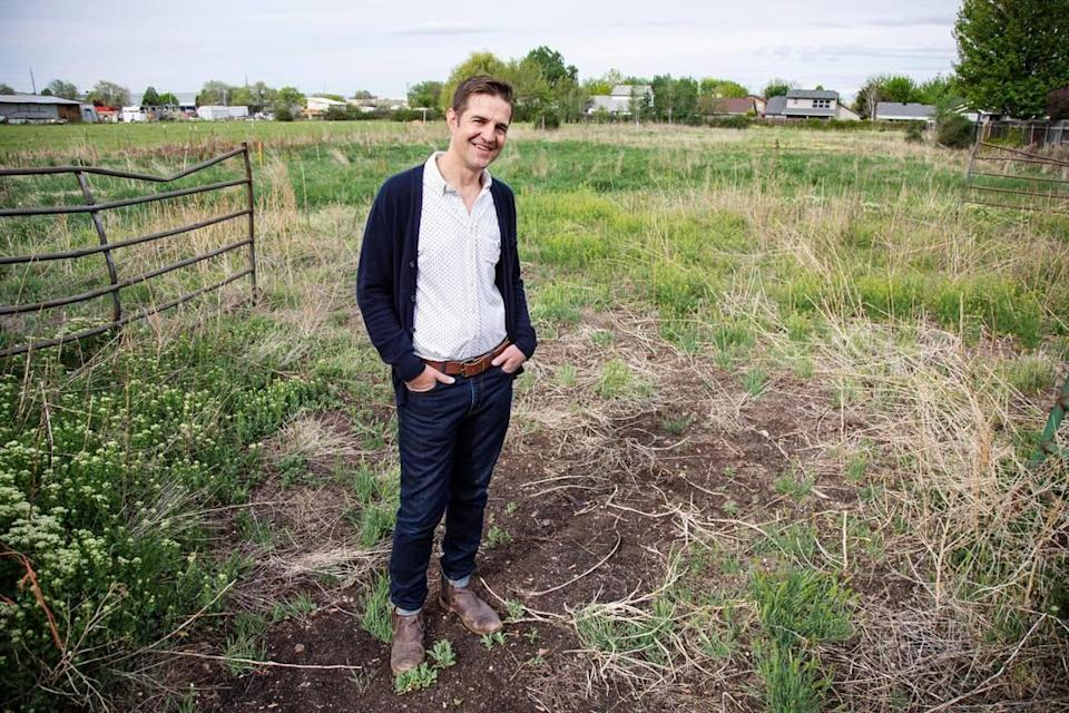 Bart Cochran, executive director of Leap Housing Solutions, stands in an agricultural area that will be the future sight of Whitney Commons, on Friday, May 7, 2021 in Boise behind Shamrock Avenue. Whitney Commons will be an affordable housing subdivision featuring 11 newly constructed homes for sale and one remodeled home for rent.