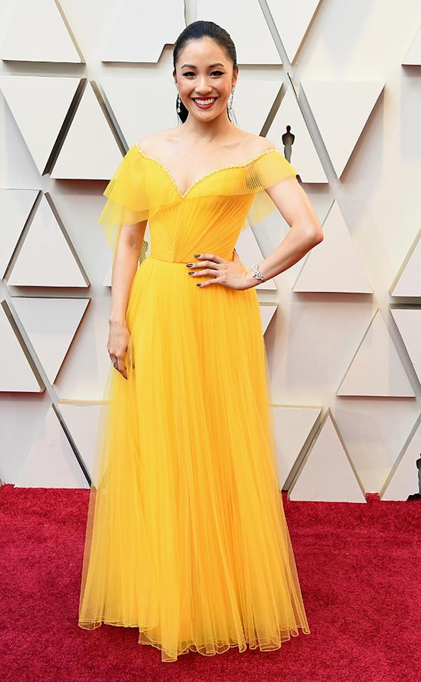 <p><em>Crazy Rich Asians</em> actress Constance Wu opted for a canary yellow frock. (Photo: Getty Images) </p>