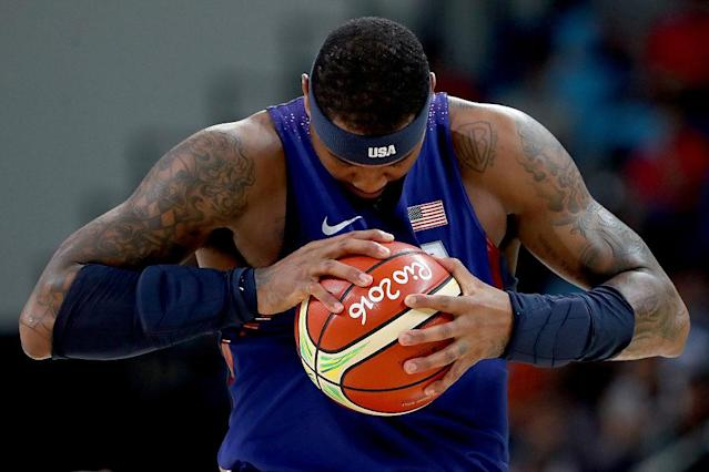 Carmelo Anthony stands on the court prior to the semifinal match against Spain. (Getty)