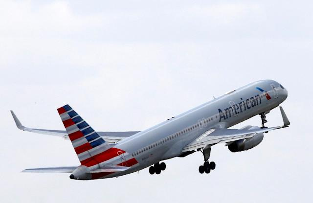 FILE PHOTO – An American Airlines Boeing 757 aircraft takes off at the Charles de Gaulle airport in Roissy, France, August 9, 2016. REUTERS/Jacky Naegelen/File Photo GLOBAL BUSINESS WEEK AHEAD SEARCH GLOBAL BUSINESS OCT 23 FOR ALL IMAGES