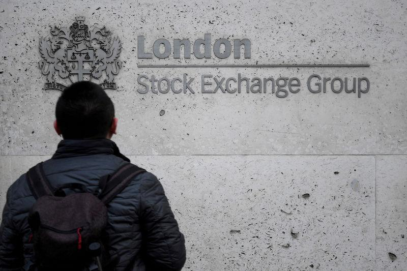 FILE PHOTO: People walk past the London Stock Exchange Group offices in the City of London, Britain, December 29, 2017. REUTERS/Toby Melville
