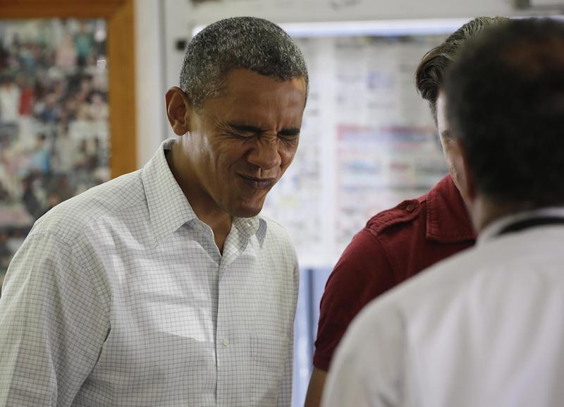 President Barack Obama makes a face as he greets young children and their parents during his unannounced stop to West Tampa Sandwich Shop and Restaurant, Saturday, Sept. 8, 2012, in Tampa, Fla. (AP Photo/Pablo Martinez Monsivais)