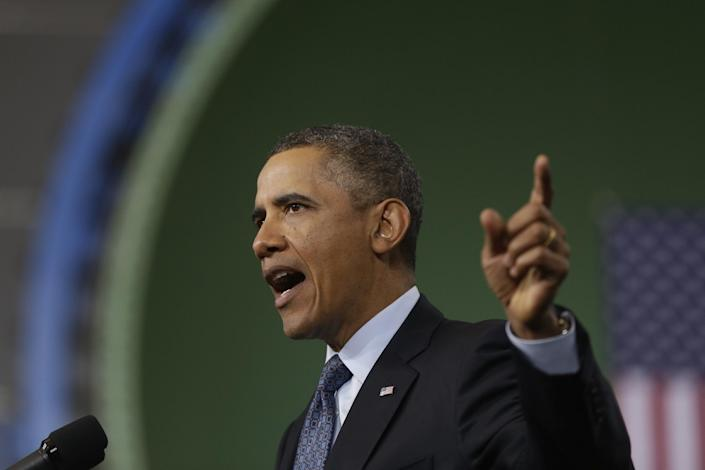 FILE - In this Feb. 26, 2013 file photo, President Barack Obama gestures as he speaks about automatic defense budget cuts during a visit to Newport News Shipbuilding, a division of Huntington Ingalls Industries in Newport News, Va. Obama is pulling out all the stops to warn just what could happen if automatic budget cuts kick in. Americans are reacting with a collective yawn. (AP Photo/Charles Dharapak)