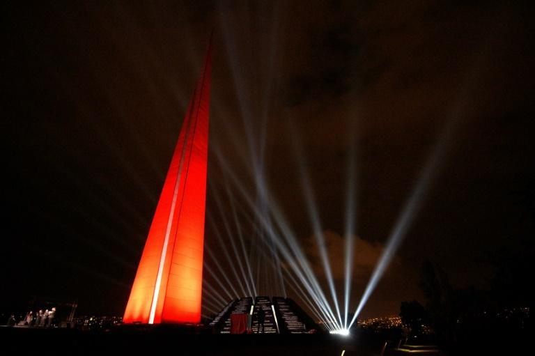 The Tsitsernakaberd Memorial complex is illuminated in Yerevan in April 2020 to commemorate those who died in the mass killing of Armenians in the Ottoman Empire during World War I