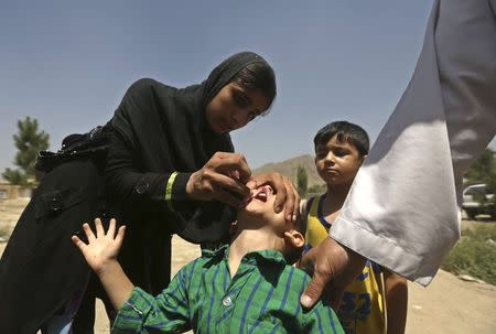 A boy receives polio vaccination drops during an anti-polio campaign in Kabul, in this file picture taken August 18, 2014. REUTERS/Omar Sobhani