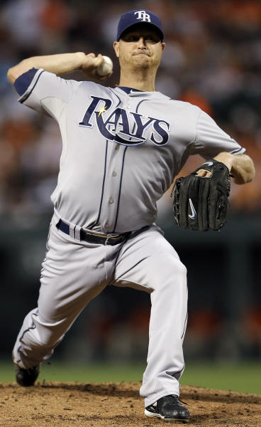 Tampa Bay Rays starting pitcher Alex Cobb throws to the Baltimore Orioles in the first inning of a baseball game in Baltimore, Wednesday, Sept. 12, 2012. (AP Photo/Patrick Semansky)