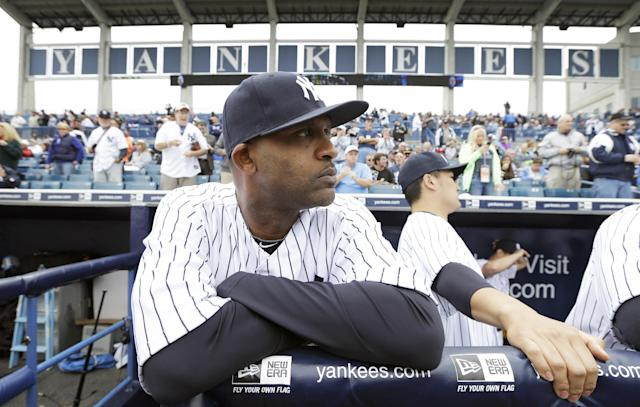 New York Yankees starting pitcher CC Sabathia stands in the dugout before an exhibition baseball game against the Pittsburgh Pirates Thursday, Feb. 27, 2014, in Tampa, Fla. (AP Photo/Charlie Neibergall)