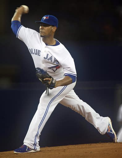 Toronto Blue Jays starting pitcher Esmil Rogers pitches to the Tampa Bay Rays during the first inning of a baseball game in Toronto on Friday, July 19, 2013. (AP Photo/The Canadian Press, Frank Gunn)