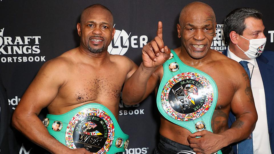 Roy Jones Jr and Mike Tyson, pictured here celebrating their split draw.