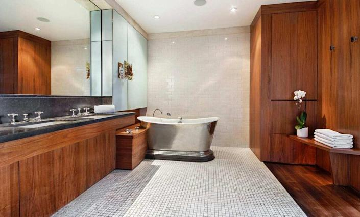 Spacious contemporary bathroom inside David Bowie's old Manhattan apartment, recently sold for $16.8 million.