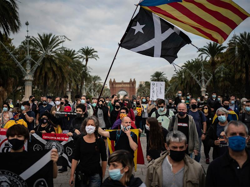 Catalan separatist demonstrators during a protest in Barcelona on 9 October against the visit of Spanish King Felipe VI and Prime Minister Pedro Sanchez (AP)
