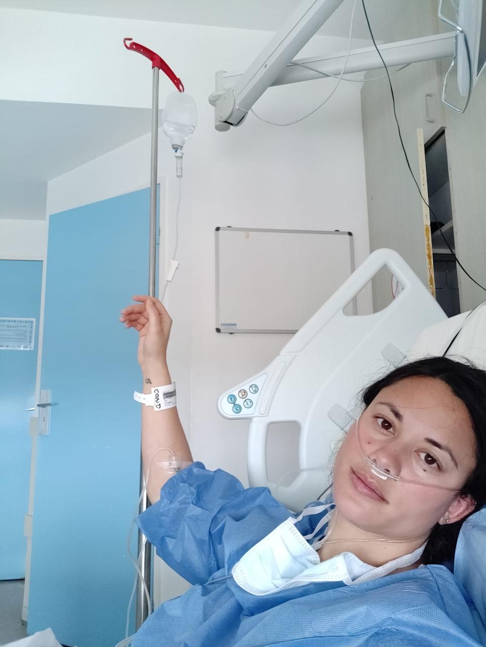 Pictured is Intan Clement in a hospital bed after contracting coronavirus.