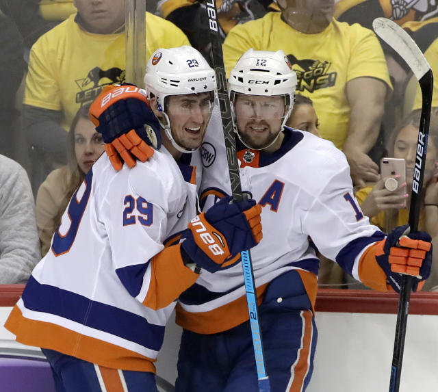 New York Islanders' Brock Nelson (29) celebrates his goal with Josh Bailey (12) during the first period in Game 4 of an NHL first-round hockey playoff series against the Pittsburgh Penguins in Pittsburgh, Tuesday, April 16, 2019. (AP Photo/Gene J. Puskar)