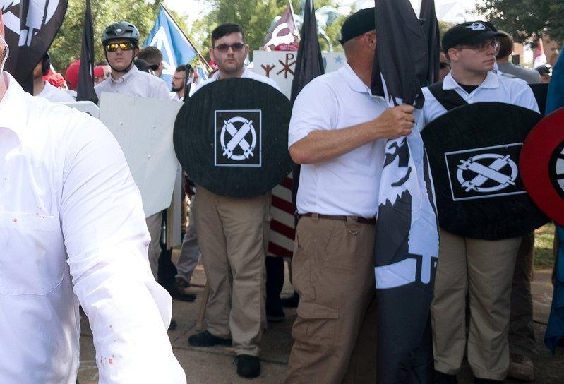James Alex Fields Jr., (2nd L with shield) is seen attending the