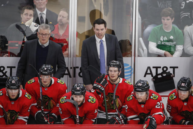 Chicago Blackhawks coach Jeremy Colliton, center, yells to his team during the third period of an NHL hockey game against the Anaheim Ducks on Saturday, Jan. 11, 2020, in Chicago. (AP Photo/Kamil Krzaczynski)